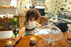 Amani-serving-coffee